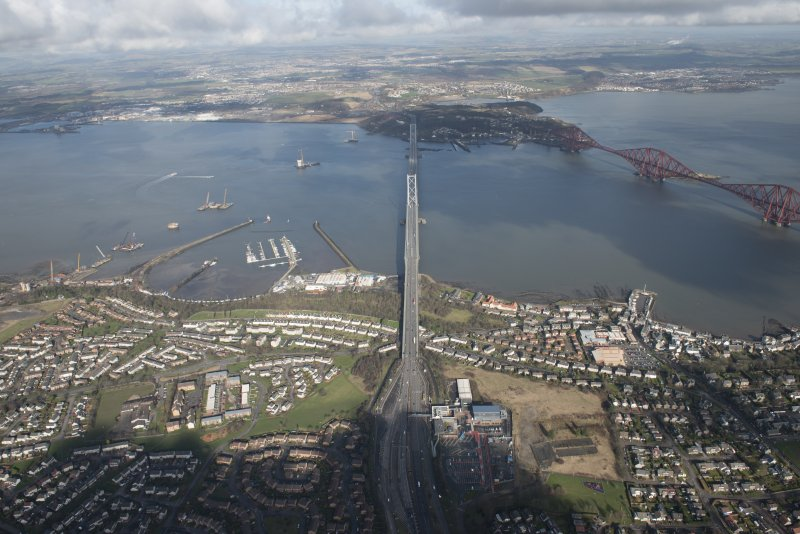 General oblique aerial view of the construction of the new Queensferry, the Forth Road Bridge and Port Edgar, looking N.