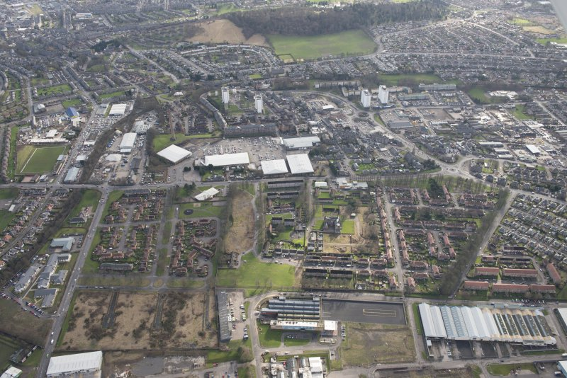 Oblique aerial view of Lochee and Camperdown Works, looking SSW.