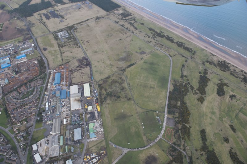 Oblique aerial view of Montrose Airfield, looking NE.