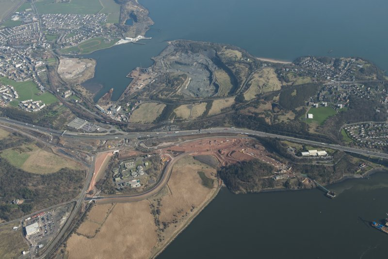 Oblique aerial view of the Queensferry Crossing construction, Inverkeithing Bay and Cruiks Quarry, looking to the ENE.