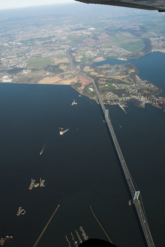 Oblique aerial view of the Forth Road Bridge and Queensferry Crossing construction, looking to the N.