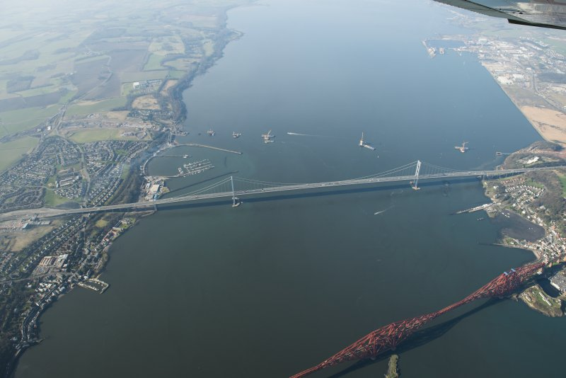 Oblique aerial view of the Forth Bridge, Forth Road Bridge and Queensferry Crossing construction, looking to the W.