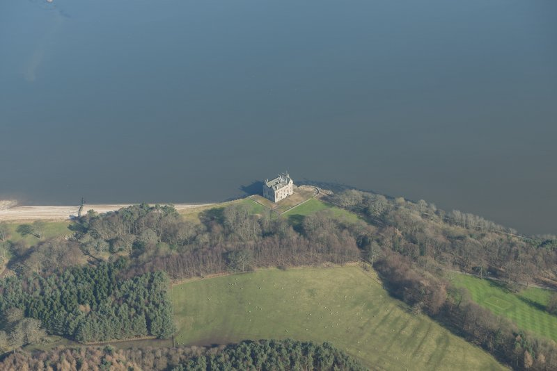 Oblique aerial view of Barnbougle Castle, looking to the NE.
