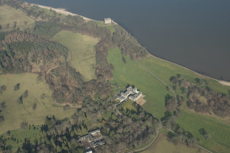 Oblique aerial view of Dalmeny House and Barnbougle Castle, looking to the NE.