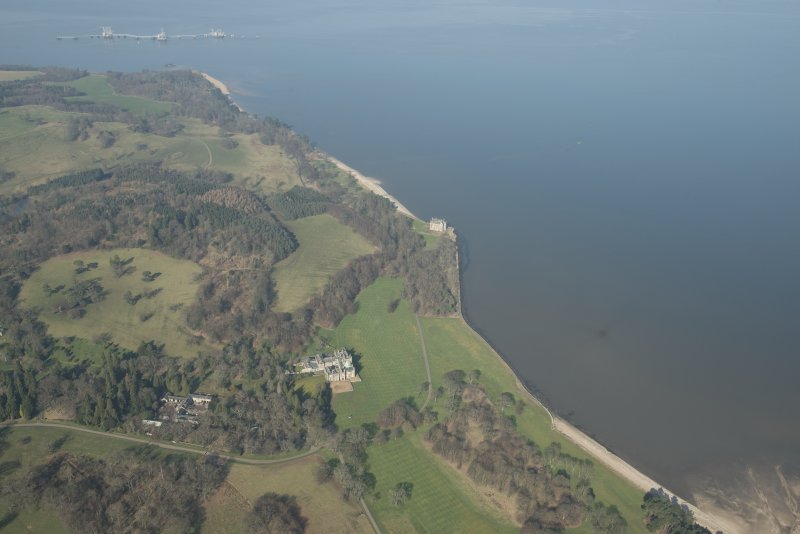 Oblique aerial view of Dalmeny House and Barnbougle Castle, looking to the N.