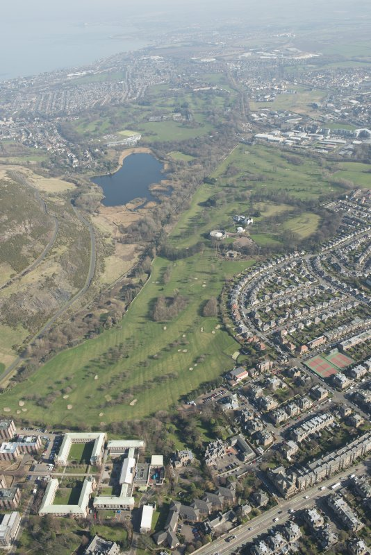 Oblique aerial view of Prestonfield Golf Course and Duddingston Loch, looking to the NNE.