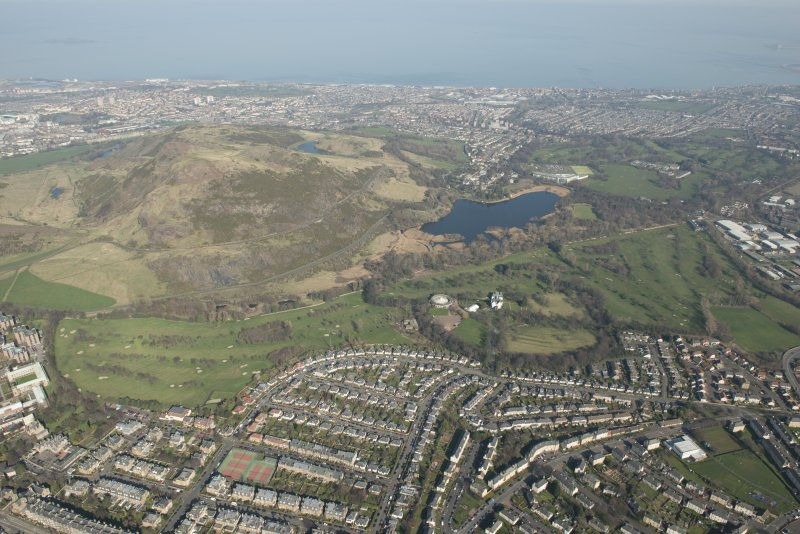 General oblique aerial view of Prestonfield Golf Course, Arthur's seat and Holyrood Park centred on Duddingston Loch, looking to the N.