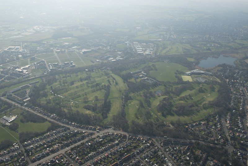 Oblique aerial view of Duddingston House and golf course and Holyrood Roman Catholic Secondary School, looking to the SW.