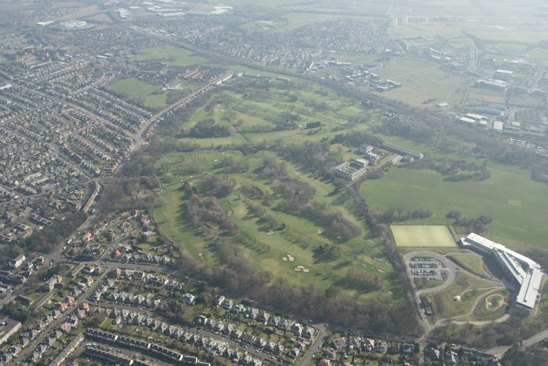 Oblique aerial view of Duddingston House and golf course and Holyrood Roman Catholic Secondary School, looking to the SE.
