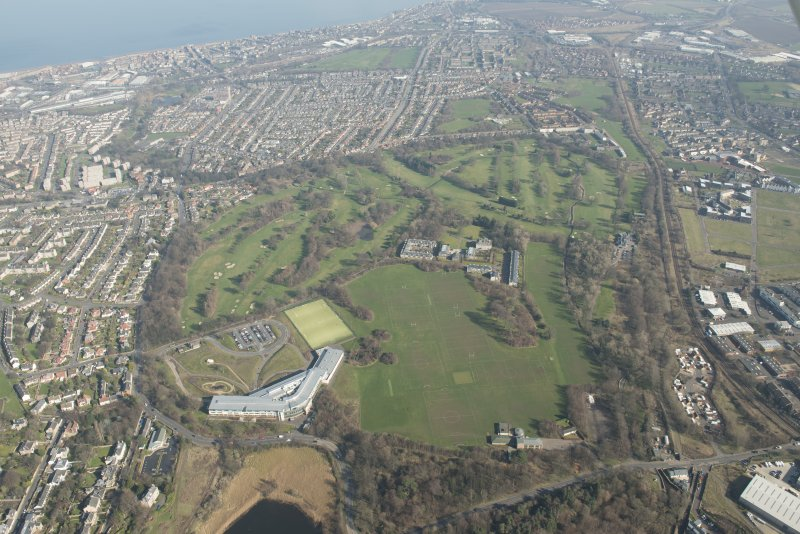Oblique aerial view of Duddingston House and golf course and Holyrood Roman Catholic Secondary School, looking to the ENE.