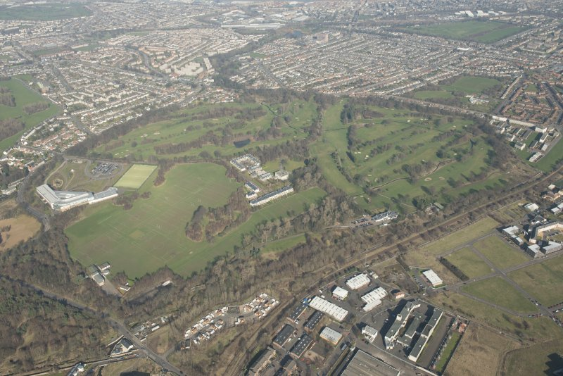 Oblique aerial view of Duddingston House and golf course and Holyrood Roman Catholic Secondary School, looking to the NNE.