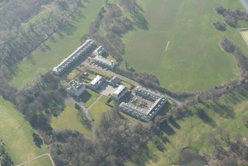 Oblique aerial view of Duddingston House Hotel, looking to the SW.