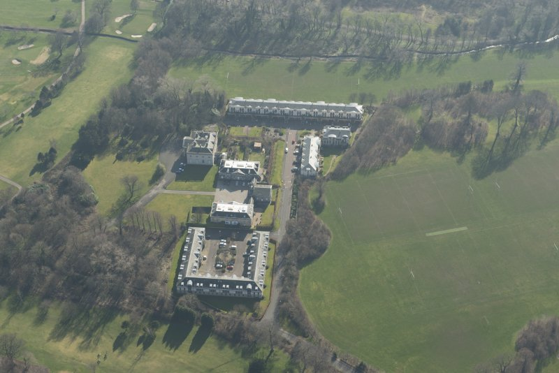 Oblique aerial view of Duddingston House Hotel, looking to the S.