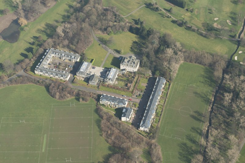 Oblique aerial view of Duddingston House Hotel, looking to the ENE.