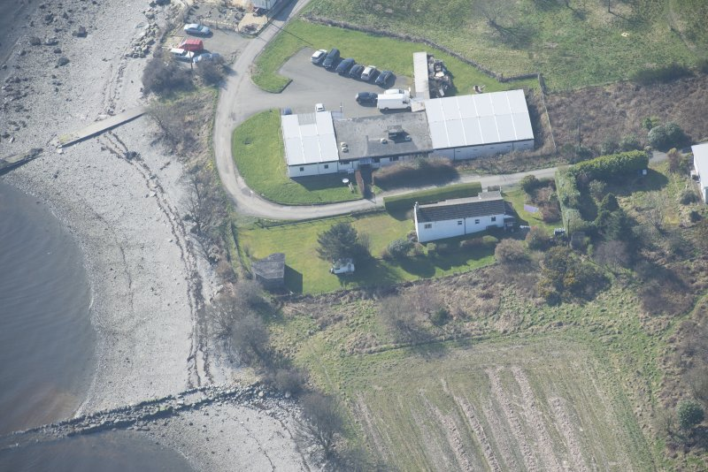 Oblique aerial view of the pillbox and RA store, looking WSW.
