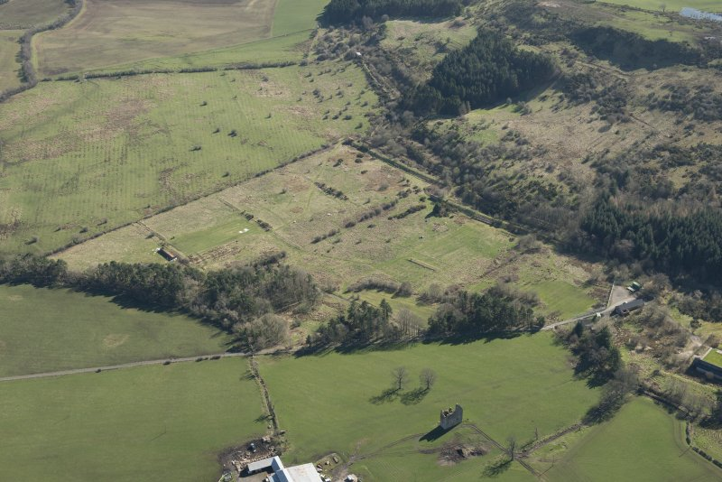 Oblique aerial view of part of the Dechmont Rifle Ranges and Gilbertfield Castle, looking ESE.