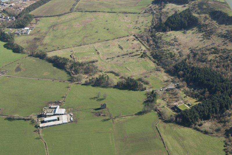 Oblique aerial view of part of the Dechmont Rifle Ranges and Gilbertfield Castle, looking E.