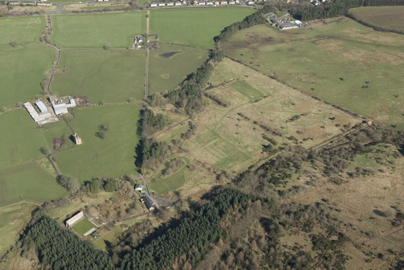Oblique aerial view of part of the Dechmont Rifle Ranges and Gilbertfield Castle, looking N.