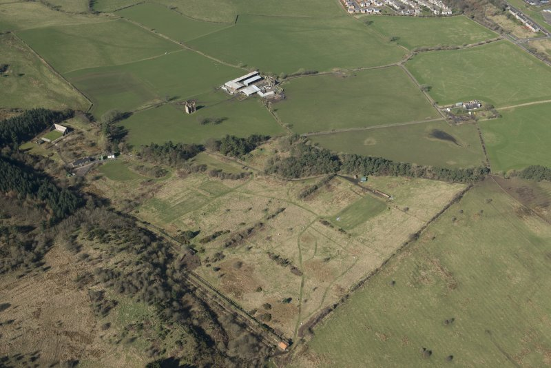 Oblique aerial view of part of the Dechmont Rifle Ranges and Gilbertfield Castle, looking WNW.