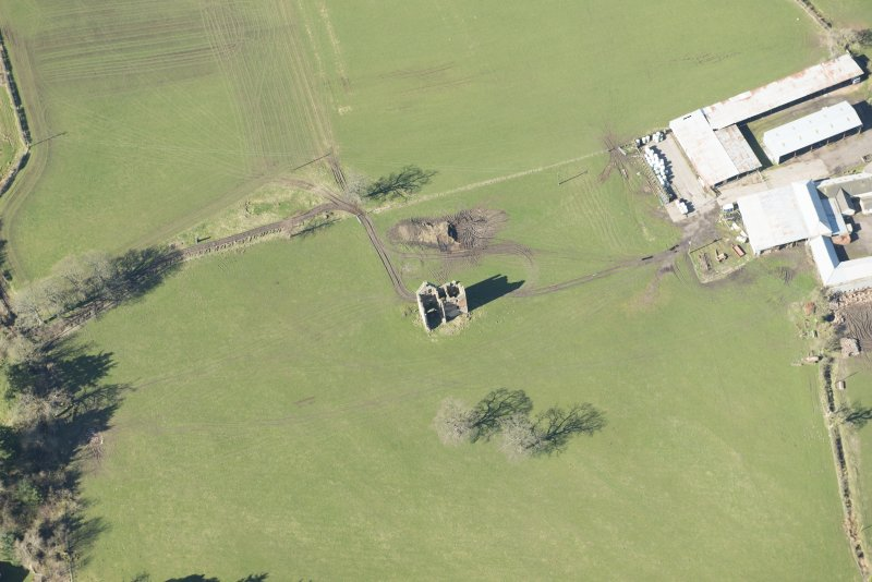 Oblique aerial view of Gilbertfield Castle, looking W.