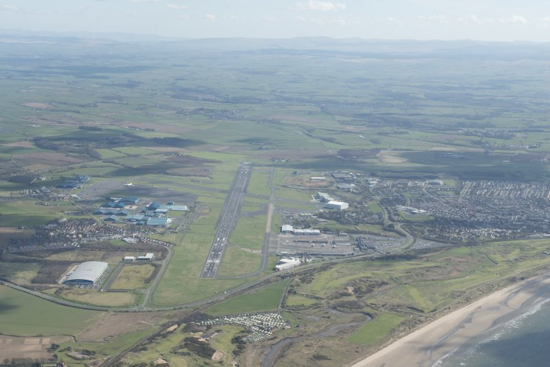 Oblique aerial view of Prestwick Golf Course and Prestwick Airport, looking SE.