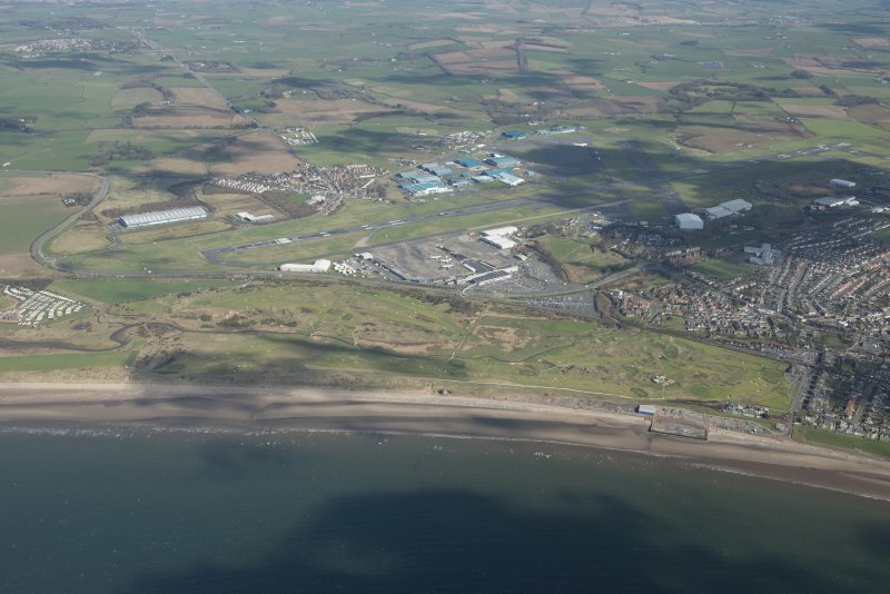 Oblique aerial view of Prestwick Golf Course and Prestwick Airport, looking NE.