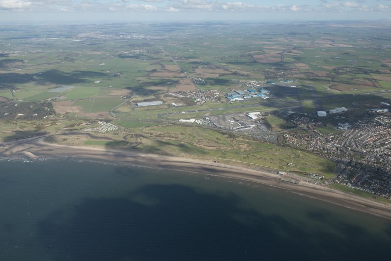Oblique aerial view of Prestwick Golf Course and Prestwick Airport, looking NNE.