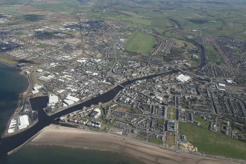 Oblique aerial view of Ayr and main harbour, looking E.