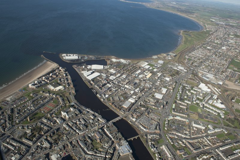 Oblique aerial view of Ayr and main harbour, looking NW.