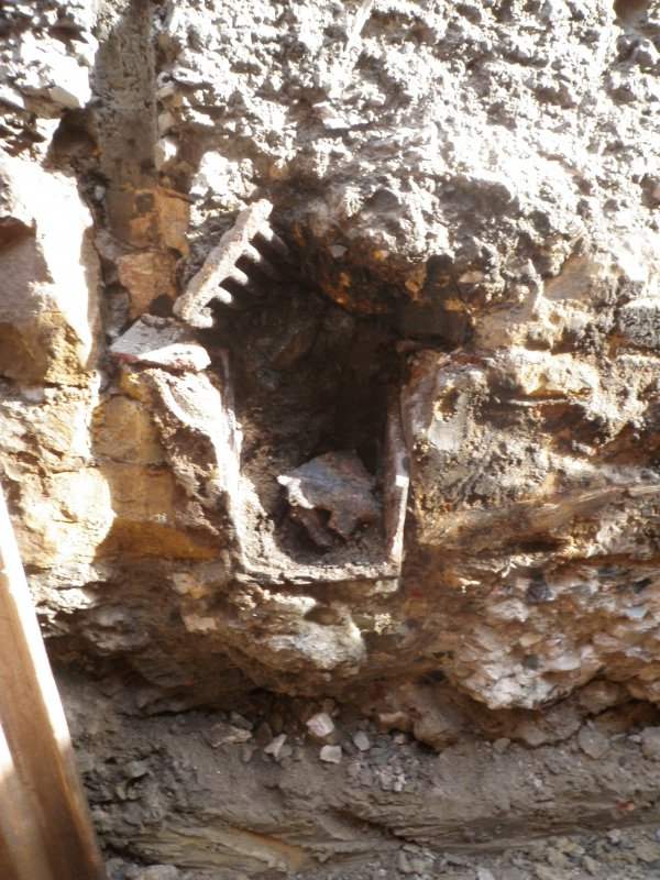 Detail of drain I S facing section of trench 1 cut into the wall
