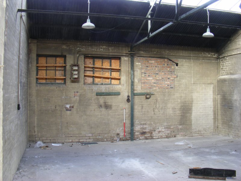 View of N interior wall of unit 4 in Building 10