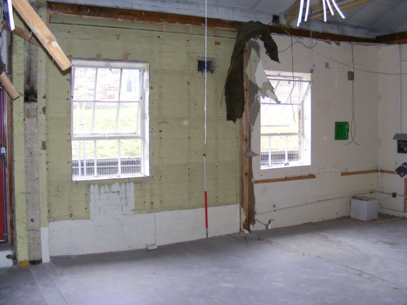 S wall of rooms 8/9 in Building 8