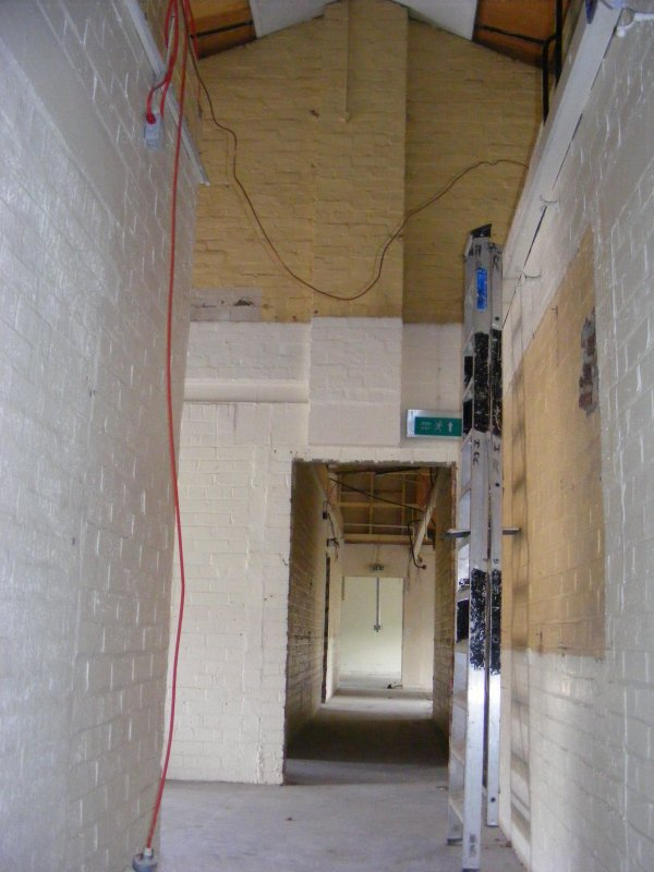 W side of partion wall to rooms 2 and 10 in Building 8