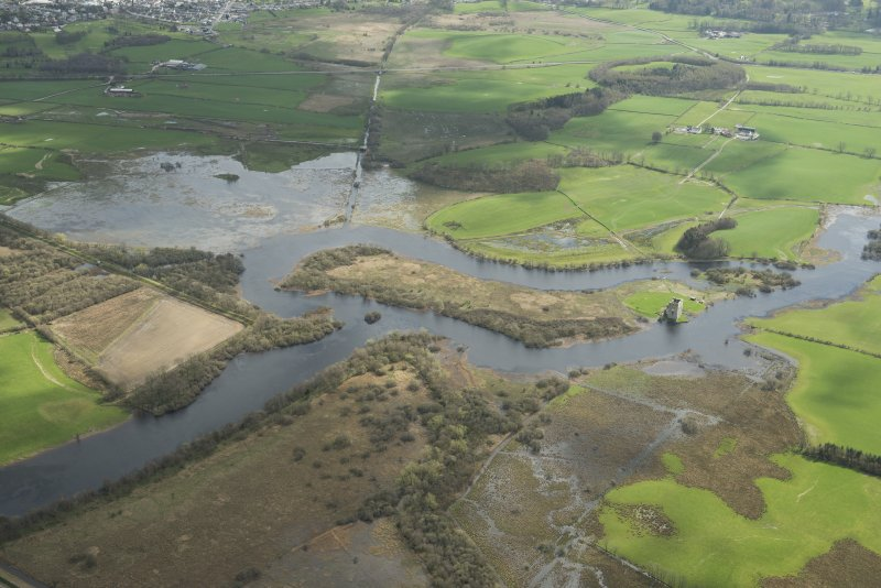 Oblique aerial view showing the flooding along the River Dee at Threave Castle, looking SE.