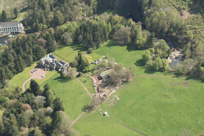 Oblique aerial view of Corra Castle and Corehouse Country House, looking ESE.