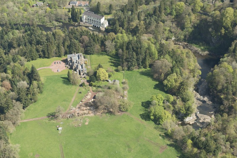Oblique aerial view of Corra Castle and Corehouse Country House, looking NE.