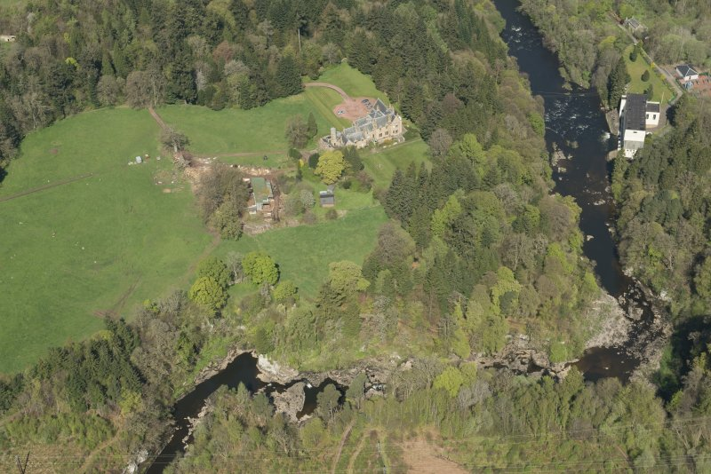 Oblique aerial view of Corra Castle and Corehouse Country House, looking N.
