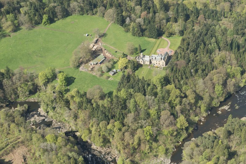 Oblique aerial view of Corra Castle and Corehouse Country House, looking NW.