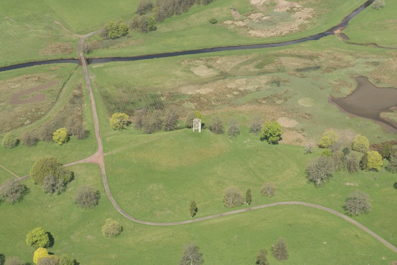 Oblique aerial view of Douglas Castle and former ornamental garden, looking NNW.