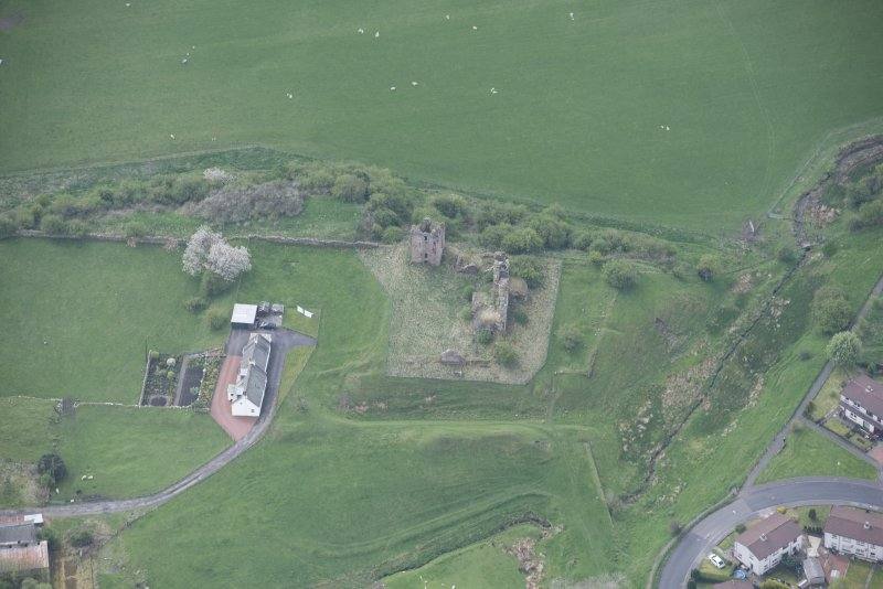 Oblique aerial view of Sanquhar Castle, looking NE.