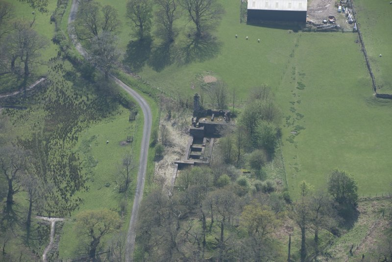 Oblique aerial view of Lochwood Tower, looking S.