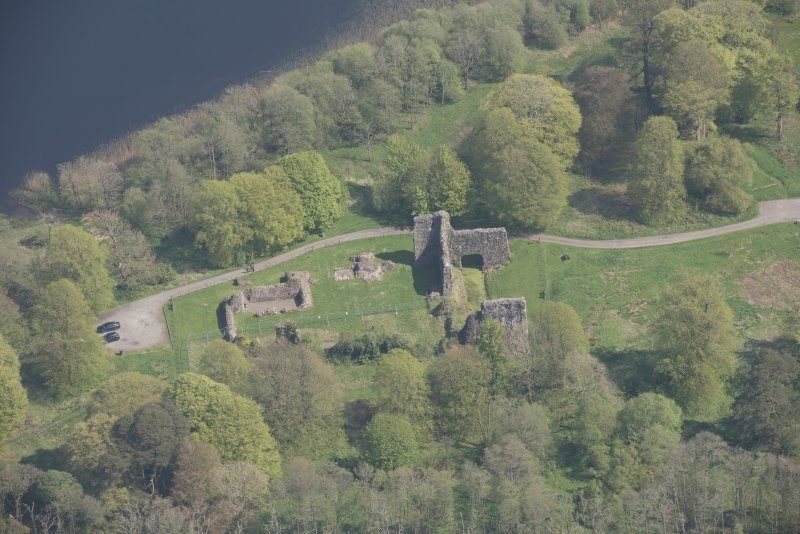 Oblique aerial view of Lochmaben Castle, looking E.