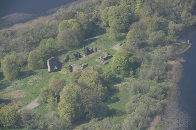Oblique aerial view of Lochmaben Castle, looking WNW.