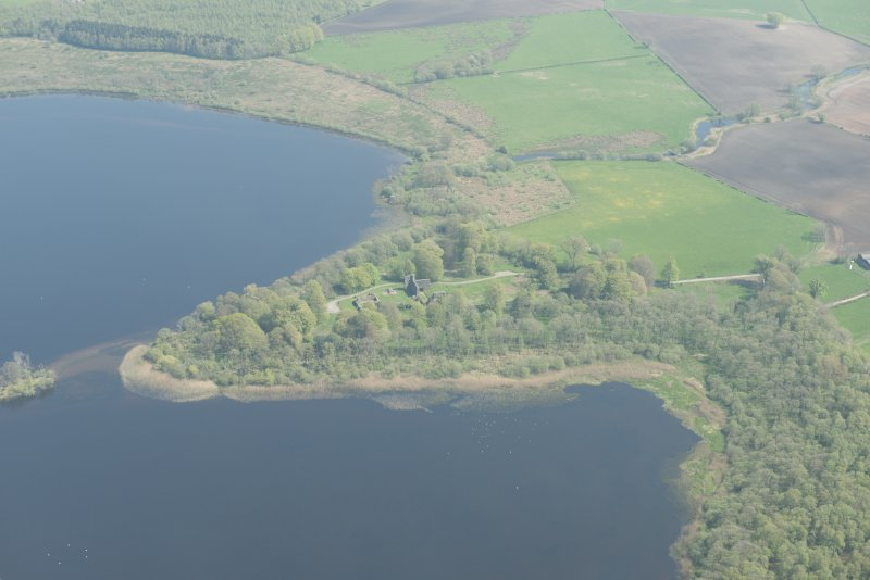 General oblique aerial view of Lochmaben Castle, looking E.