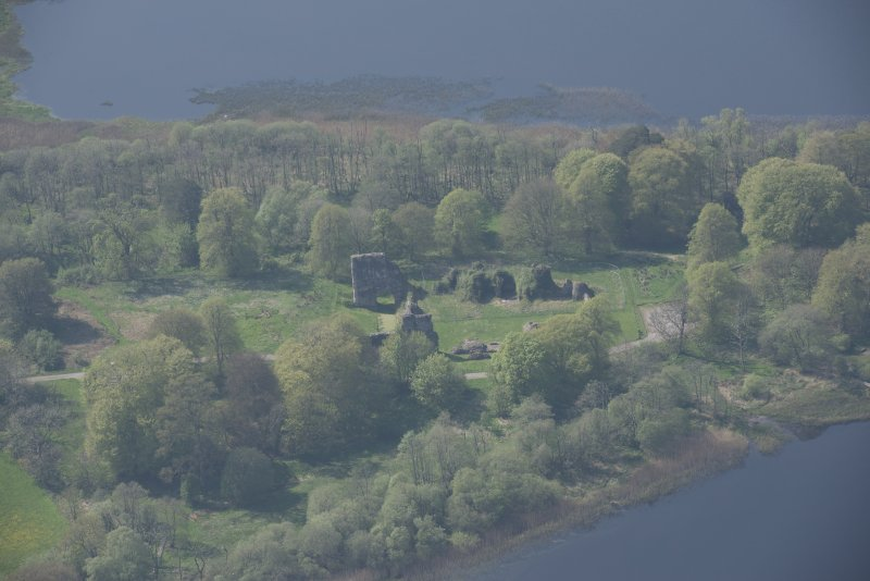 Oblique aerial view of Lochmaben Castle, looking WSW.