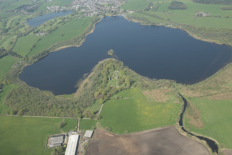 Oblique aerial view of Lochmaben Castle, looking NNW.
