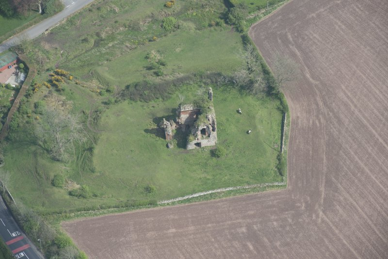 Oblique aerial view of Torthorwald Castle, looking E.