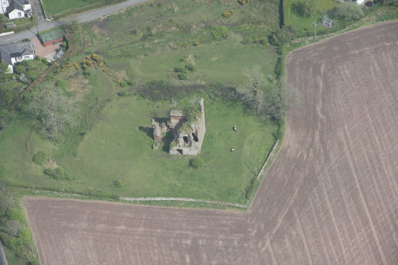 Oblique aerial view of Torthorwald Castle, looking ENE.