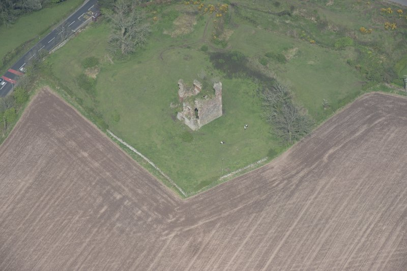 Oblique aerial view of Torthorwald Castle, looking NE.
