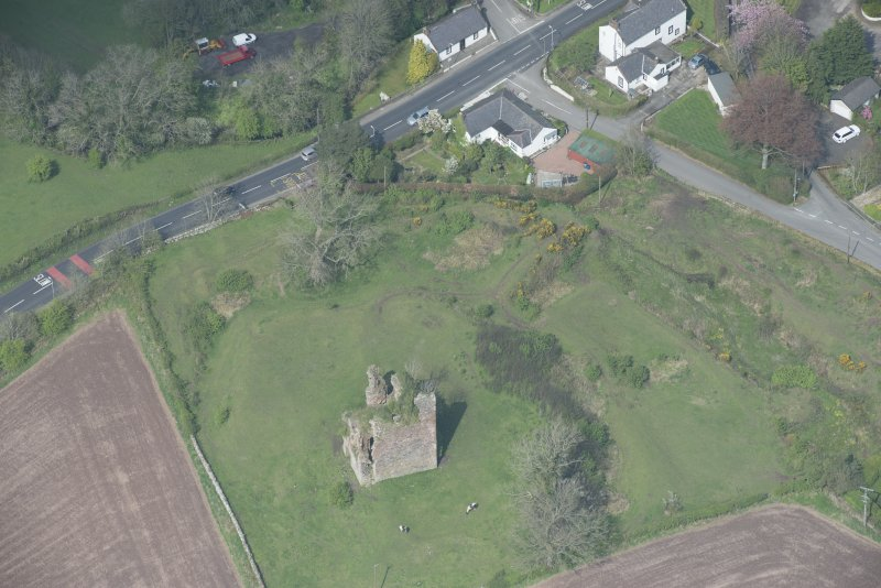 Oblique aerial view of Torthorwald Castle, looking NNE.